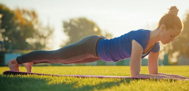 fit woman doing plank