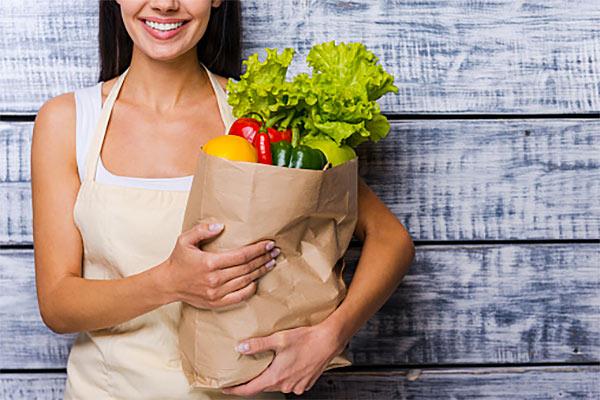 woman vegetables groceries